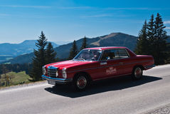 Vintage car. SOMMERALM, AUSTRIA - APRIL 27:Herbert Temmel in a 1973 Mercedes 250 Coupe participates in a rally for vintage cars Suedsteiermark Classic on April Royalty Free Stock Photo