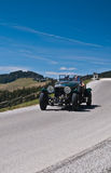 Vintage car. SOMMERALM, AUSTRIA - APRIL 27:Mike Feurstein in a 1936 Daimler Roadster Straight 8 participates in a rally for vintage cars Suedsteiermark Classic Stock Image