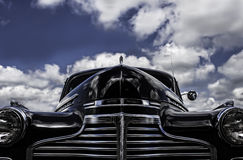 Vintage Car. Beautiful vintage car against a stunning sky stock illustration