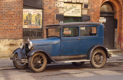 Vintage Car Against 1940s Backdrop. Vintage Ford car parked in front of a 1940s New York backdrop in the Northern Quarter area of Manchester UK during the stock photography