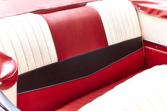 Vintage car back seat in red black and white. Beautiful upholstery from a classic convert able Royalty Free Stock Photos