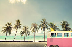 Vintage car on the beach. With a surfboard Royalty Free Stock Photography
