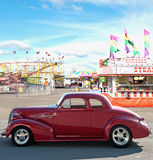 Vintage car and carnival. On a sunny day Royalty Free Stock Photography