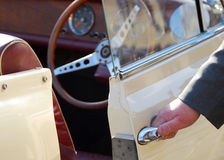 Vintage car with chaufeur Stock Images