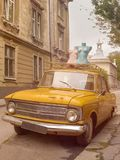 Vintage car. Classical retro car. Old style car. Vechicle concept. Mannequins on the street. stock photography