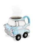 Vintage Car Coffee Cup with Steaming Coffee. Coffee to Go! Fun classic car coffee mug on wheels stock images