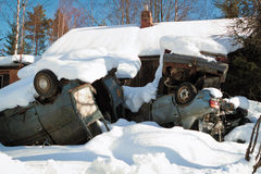 Vintage car collection. Pile of junk cars covered in snow Stock Image