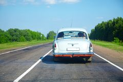 Vintage car on a countryside road Royalty Free Stock Image