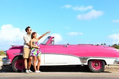 Vintage car - couple pointing Royalty Free Stock Images