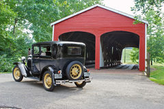 Vintage Car and Covered Bridge Royalty Free Stock Images