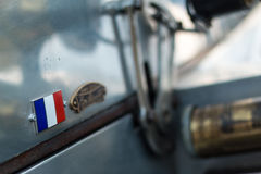 Vintage car detail - france tricolore badge Royalty Free Stock Photo
