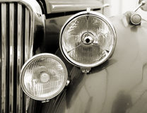 Vintage car detail. Sepia. Front detail of a classic car Stock Images