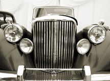 Vintage car detail. Sepia. Front detail of a classic car Royalty Free Stock Photos