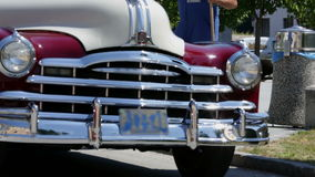 Vintage car drives towards the camera and wobbles stock footage