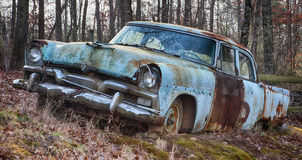 Vintage car in field abandoned Royalty Free Stock Photo