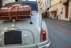 Vintage Car. Florence, Italy - APRIL 17, 2011: Vintage car meeting, back of vintage car with old suitcase, photo taken on the street Stock Photo