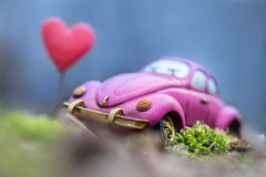 Vintage car in forest with heart Stock Photos