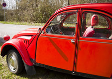 Vintage car, French Citroen 2CV red,lateral view Stock Photo