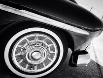 A vintage car front fender and tire. A black and white photo of a vintage car& x27;s front fender and tire stock photos
