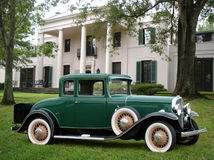 Vintage Car in Front of Mansion Stock Photography