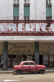 Vintage car in front of Teatro America in Havana, Cuba. An old red car parked in front of Teatro America royalty free stock images