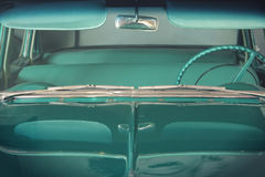 Vintage car front view. Front view of a turquoise vintage car Stock Photos