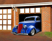Vintage car in garage. Photo of a blue ford vintage customised car kept in garage as a highly collectable vehicle Stock Photography