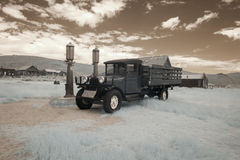 Vintage car at gas pumps in Bodie, California in infrared Stock Photography