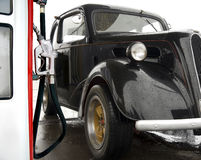 Vintage car at gas station Stock Image