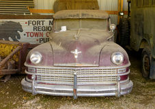 A vintage car gathering dust in fort nelson, british columbia Royalty Free Stock Photography