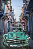 Vintage car,Havana Fantasy. Old red car against the Malecon, Havana,Cuba Royalty Free Stock Photo