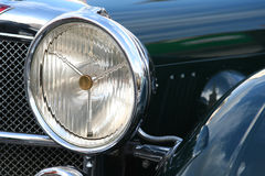Vintage car headlight. Black retro car detail of headlight royalty free stock photo