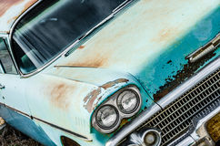 Vintage car headlights. Vintage old classic car headlights on a blue rusty vehicle stock images