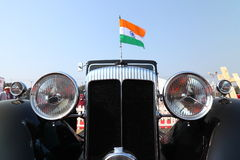 Vintage car with India national flag Royalty Free Stock Photo