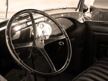 Vintage Car Interior. 1929 Ford Model A worn interior with sunlight shining through the window stock photo