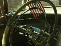Vintage car interior with flag Royalty Free Stock Image