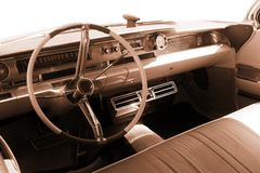 Vintage car, interior - sepia Stock Images