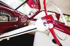 Vintage car interior - steering wheel and dashboard.  Stock Photography
