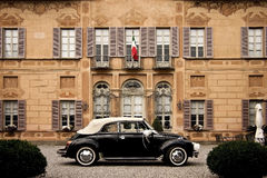 Vintage car and Italian building. Stock Photos