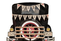 Vintage car with just married decoration royalty free stock photos