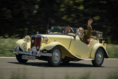 Vintage car. KNITTELFELD, AUSTRIA - MAY 18:Gerald Dunst in a 1952 MG TD participates in a rally for vintage cars 15 Murtal Classic on May 18, 2013 in Knittelfeld Stock Photo