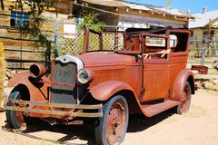 A vintage car left abandoned near the Hackberry General Store. Hackberry General Store is famous stop on the historic Route 66 stock photo