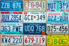 Vintage car license plates on a wall Royalty Free Stock Photography