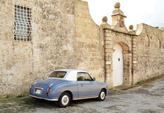 Vintage car next to an old house - Malta. Vintage car in front of an old house in the countryside Stock Photos