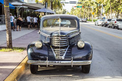 Vintage car at the Ocean Drive in Miami Beach Royalty Free Stock Image