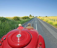 Vintage car open road touring Royalty Free Stock Photography