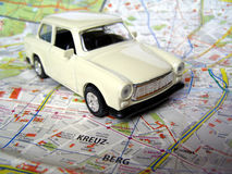 Vintage car over map. Scale model of a Trabant (East Germany communist car) over a Berlin map Stock Images