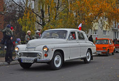 Vintage car during a parade. Old Polish classic car Warszawa 223 and a small Polski Fiat 126p during a parade in Gdansk, Poland Stock Photography