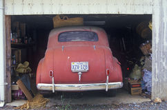 Vintage car parked in garage. Rear view of antique red car in garage, Virginia Royalty Free Stock Photos
