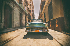 Vintage car parked in Havana street Royalty Free Stock Images